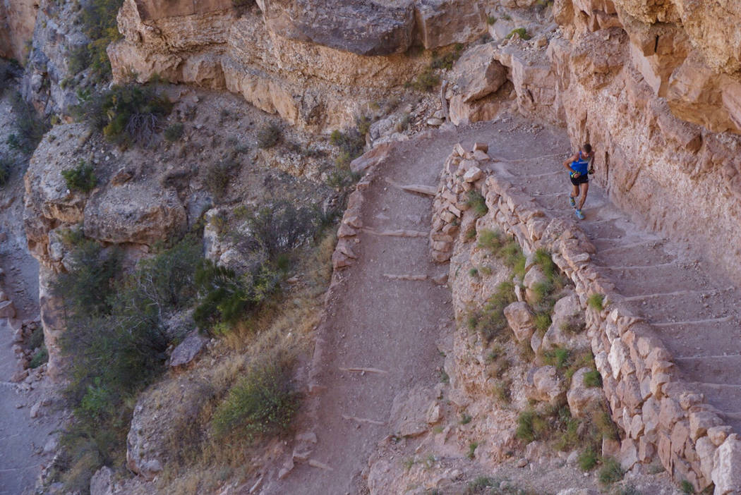 This Sunday, Oct. 1, 2017, photo provided by HOKA One One shows professional trail runner Tim Freriks running to break the single crossing record (rim-to-rim, or R2R) in the Grand Canyon, Arizona. ...
