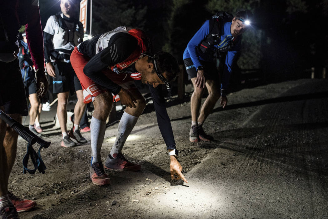 This Tuesday, Oct. 17, 2017, photo provided by Salomon shows professional trail runner Francois D'haene, left, at the completion of his journey, as he touches the Happy Isles Loop Road at the end  ...