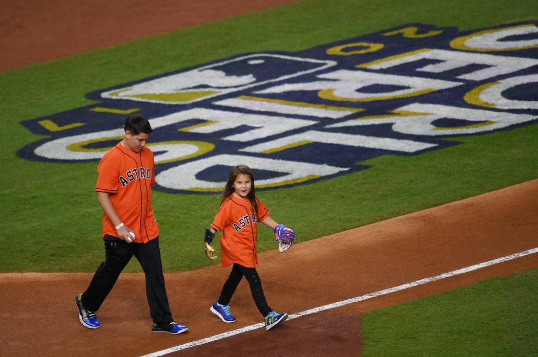 Oct 28, 2017; Houston, TX, USA; Hailey Dawson comes out for the ceremonial first pitch before game four of the 2017 World Series between the Houston Astros and the Los Angeles Dodgers at Minute Ma ...