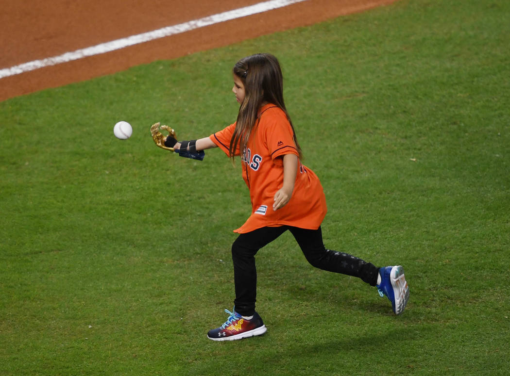 Oct 28, 2017; Houston, TX, USA; Hailey Dawson throws out the ceremonial first pitch before game four of the 2017 World Series between the Houston Astros and the Los Angeles Dodgers at Minute Maid  ...
