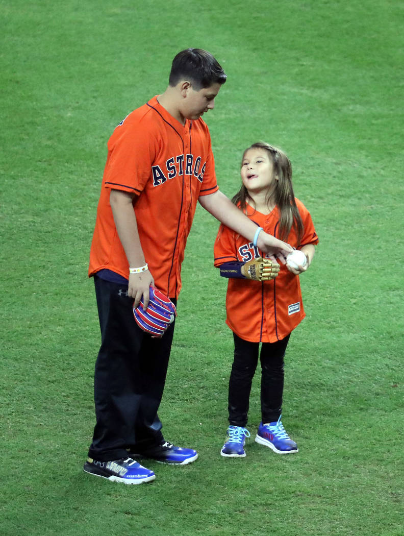 Oct 28, 2017; Houston, TX, USA; Hailey Dawson prepares to throw out the ceremonial first pitch before game four of the 2017 World Series between the Houston Astros and the Los Angeles Dodgers at M ...