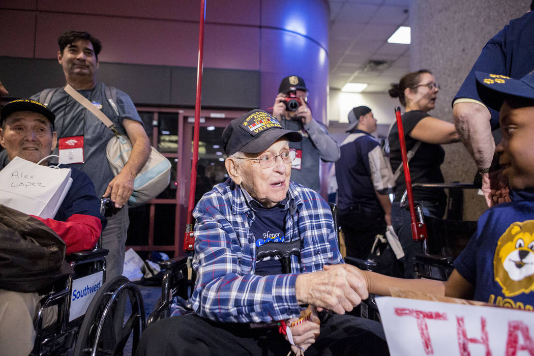 World War II and Korean War Veteran Aj Crowl is greeted at McCarran International Airport after returning to Las Vegas from Washington, D.C. from an Honor Flight Southern Nevada, Sunday, Oct. 29,  ...