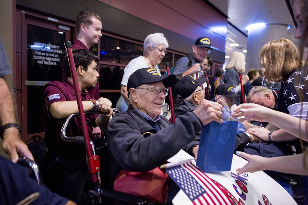 World War II Veteran Vernon Koenig is greeted at McCarran International Airport after returning to Las Vegas from Washington, D.C. from an Honor Flight Southern Nevada, Sunday, Oct. 29, 2017. Koen ...