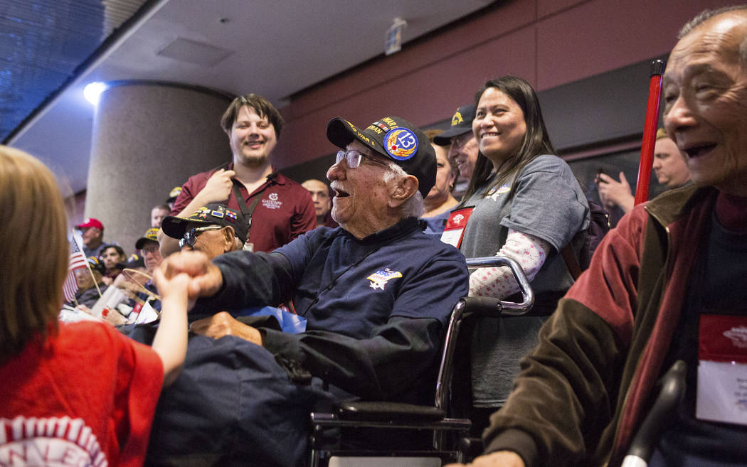 World War II Veteran Joe Pena is greeted at McCarran International Airport after returning to Las Vegas from Washington, D.C. from an Honor Flight Southern Nevada, Sunday, Oct. 29, 2017. Pena was  ...