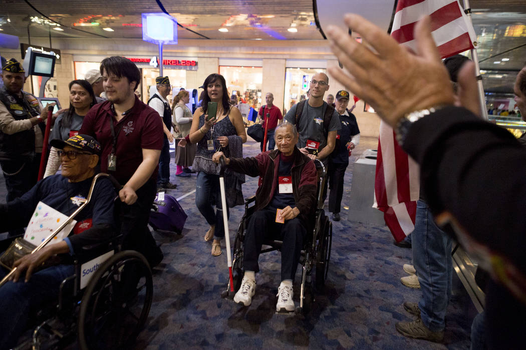 World War II and Korean War Veterans are greeted at McCarran International Airport after returning to Las Vegas from Washington, D.C. from an Honor Flight Southern Nevada, Sunday, Oct. 29, 2017. 2 ...