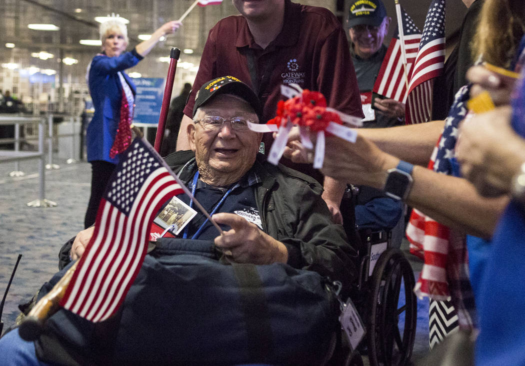 "Veteran Carl ""Bud"" Shock is greeted at McCarran International Airport after returning to Las Vegas from Washington, D.C. from an Honor Flight Southern Nevada, Sunday, Oct. 29, 20 ..."