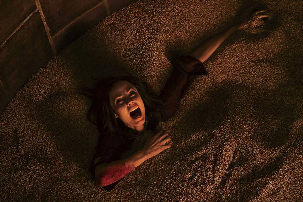 "Laura Vandervoort in the horror film, ""Jigsaw."" (Brooke Palmer/Lionsgate via AP)"