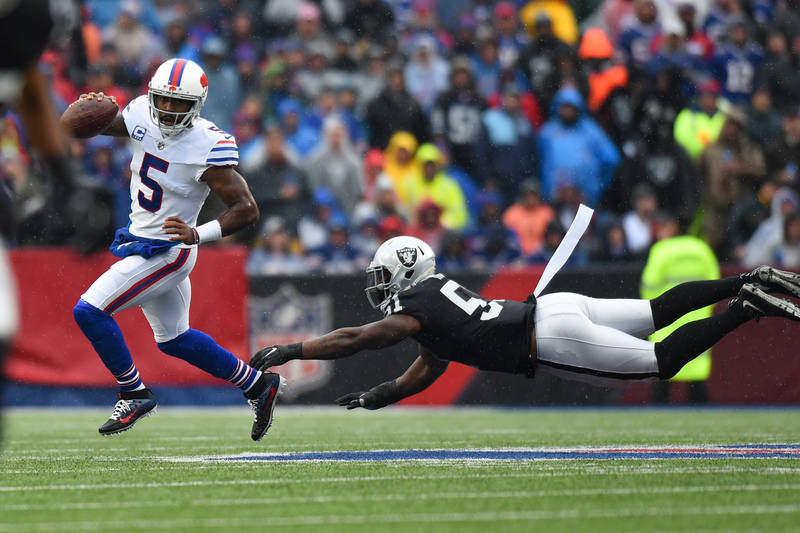 Oct 29, 2017; Orchard Park, NY, USA; Oakland Raiders outside linebacker Bruce Irvin (51) makes a diving tackle attempt on Buffalo Bills quarterback Tyrod Taylor (5) during the first quarter at New ...