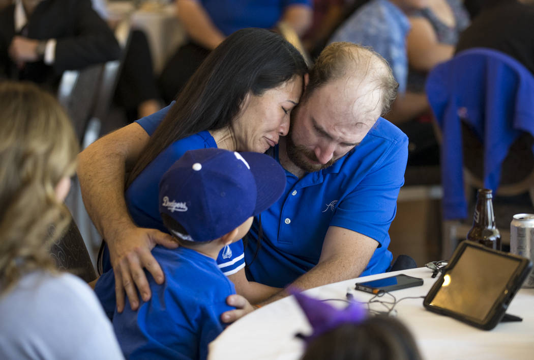 Tracy Shipp, center, sister of Route 91 Harvest shooting victim Laura Shipp, is comforted by her husband Michael LaMarca and eight-year-old son Trevor during a memorial service for her sister in W ...