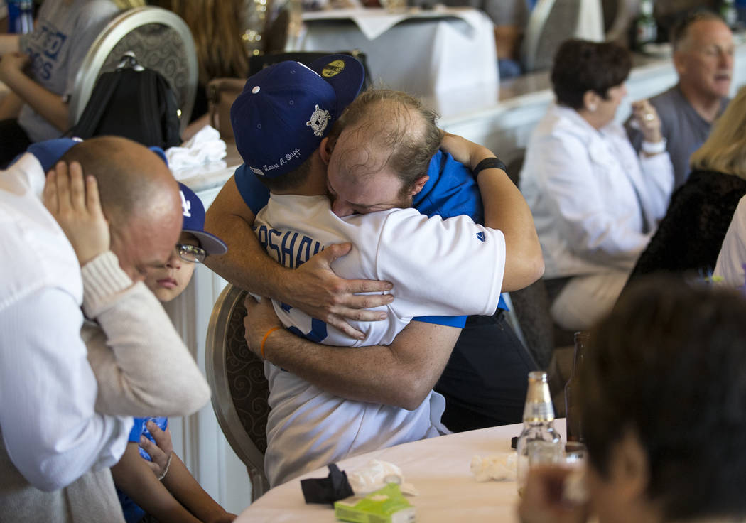 Corey Shipp, left, son of Route 91 Harvest shooting victim Laura Shipp, grieves with his uncle Michael LaMarca during a memorial service for his mother in Westlake Village, Calif., Sunday, Oct. 29 ...