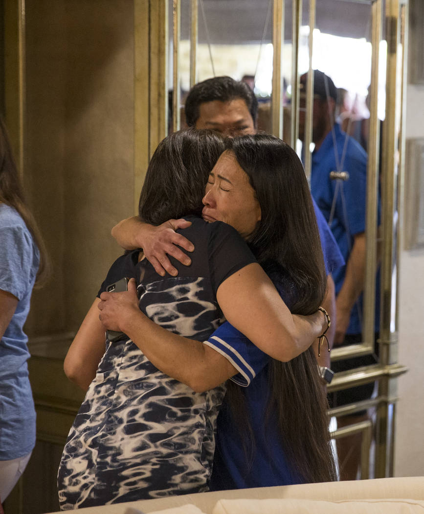 Tracy Shipp, sister of Route 91 Harvest shooting victim Laura Shipp, hugs an arriving guest during a memorial service for her sister in Westlake Village, Calif., Sunday, Oct. 29, 2017. Richard Bri ...