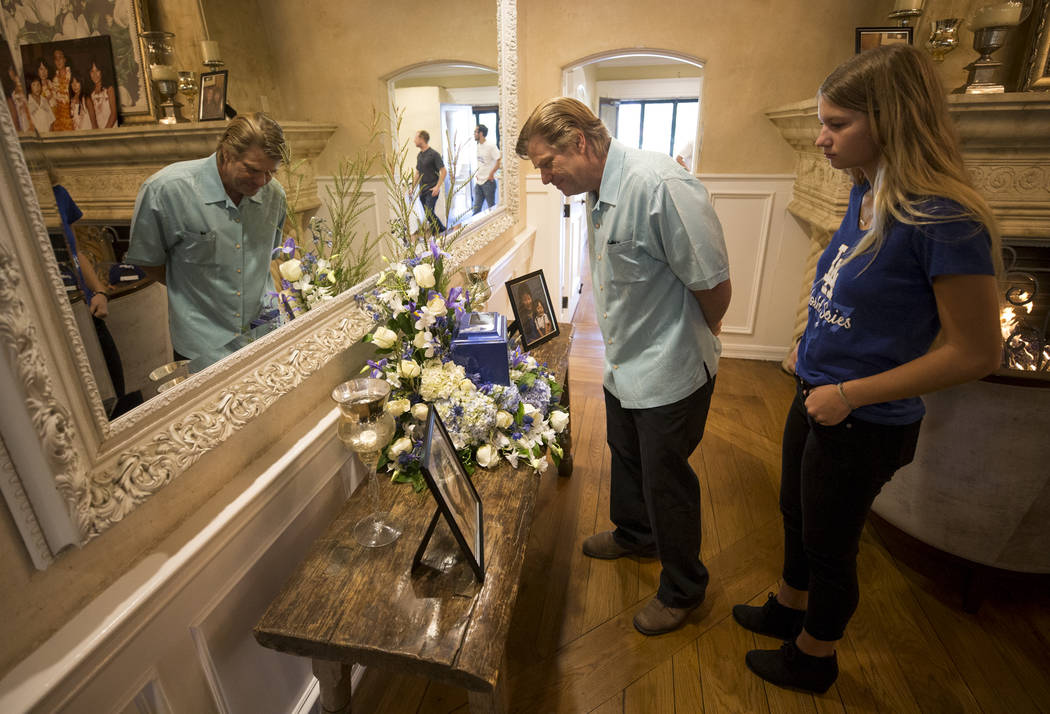 Phil Dawley and his daughter Amanda Dawley visit the urn bearing the remains of Route 91 Harvest shooting victim Laura Shipp during a memorial service for Shipp in Westlake Village, Calif., Sunday ...