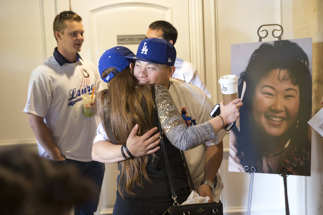 Corey Shipp, son of Route 91 Harvest shooting victim Laura Shipp, hugs an arriving guest during a memorial service for his mother in Westlake Village, Calif., Sunday, Oct. 29, 2017. Richard Brian  ...