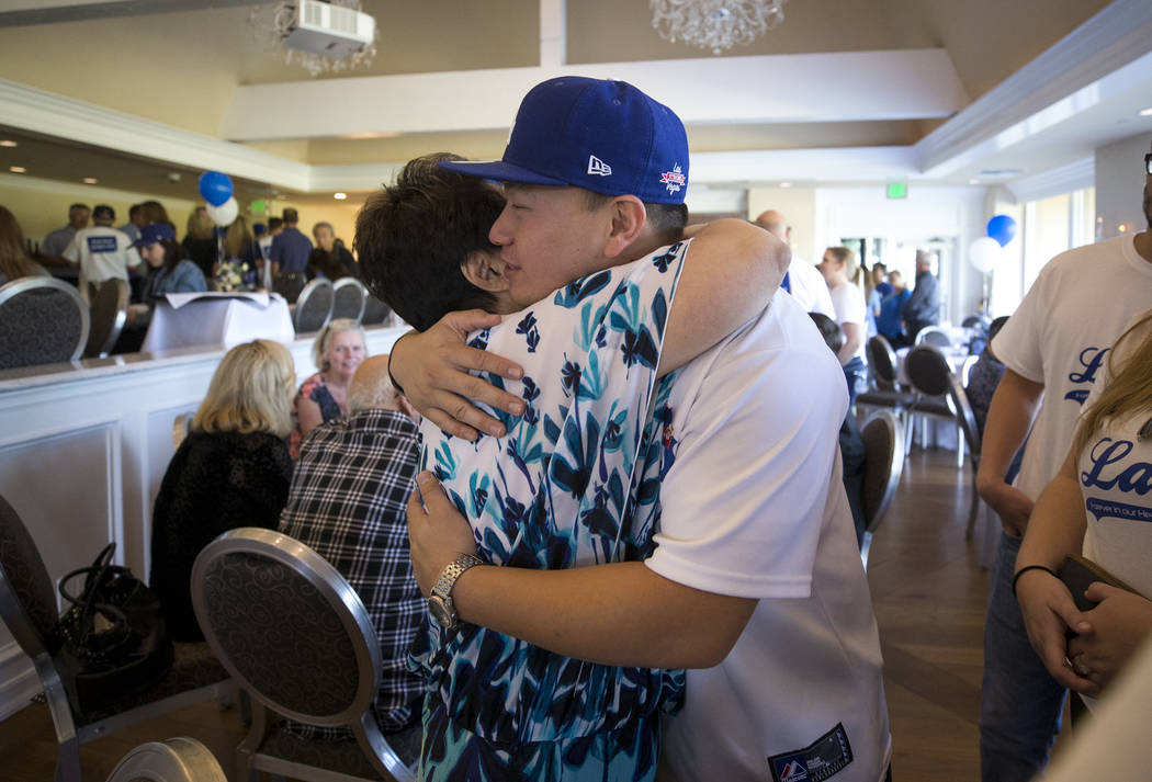 Corey Shipp, son of Route 91 Harvest shooting victim Laura Shipp, hugs his grandmother Joyce Shipp during a memorial service for his mother in Westlake Village, Calif., Sunday, Oct. 29, 2017. Rich ...