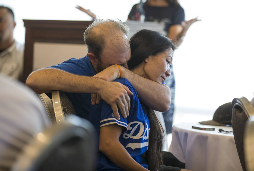 Tracy Shipp, sister of Route 91 Harvest shooting victim Laura Shipp, is comforted by her husband Michael LaMarca during a memorial service for her sister in Westlake Village, Calif., Sunday, Oct.  ...