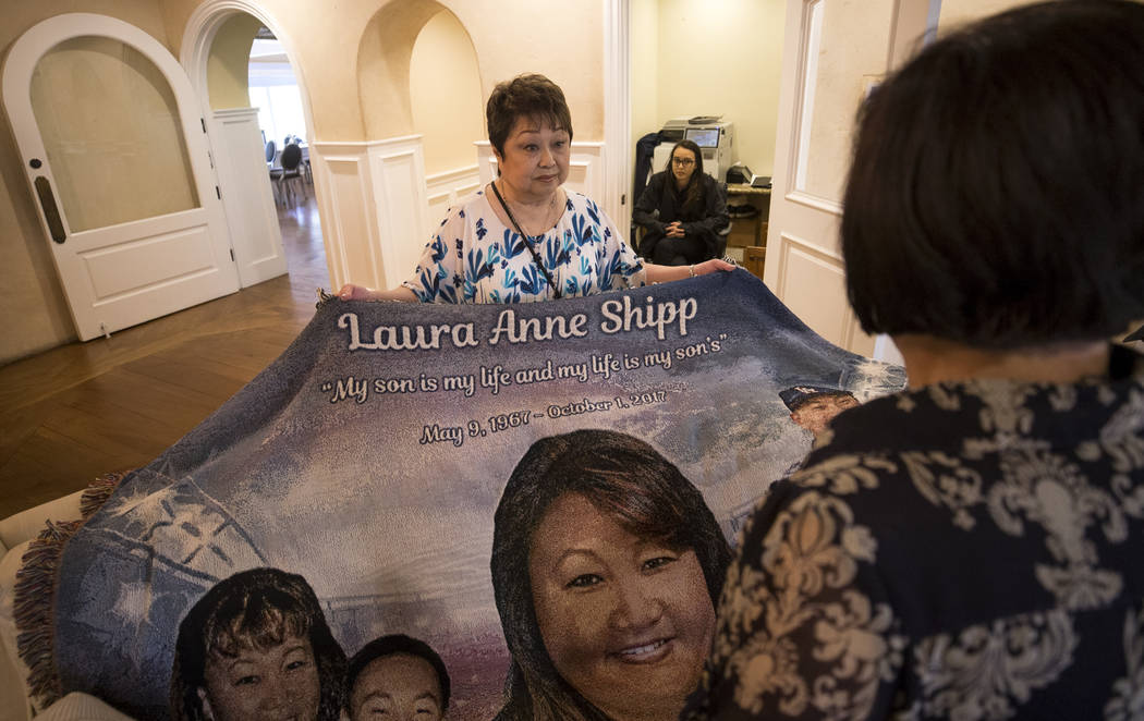 Joyce Shipp, mother of Route 91 Harvest shooting victim Laura Shipp, lays out a blanket honoring her daughter's life during a memorial service for Laura Shipp in Westlake Village, Calif., Sunday,  ...