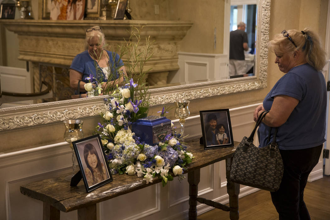 Susan Madison visits the urn bearing the remains of Route 91 Harvest shooting victim Laura Shipp during a memorial service for Shipp in Westlake Village, Calif., Sunday, Oct. 29, 2017. Madison and ...