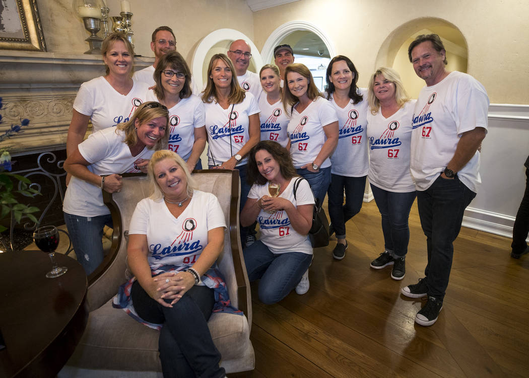 Friends and family of Route 91 Harvest shooting victim Laura Shipp pose with their Dodgers-inspired T-shirts created to pay tribute to Shipp and raise money for her family during a memorial servic ...