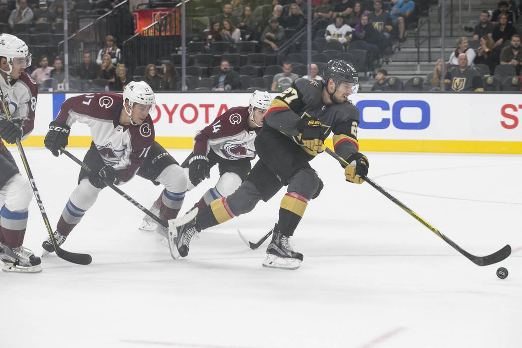 Vegas Golden Knights defenseman Shea Theodore (27) breaks away from Colorado Avalanche's Blake Comeau (14) Tyson Jost (17) and Joe Colborne (8) during the third period of a preseason NHL hockey ga ...