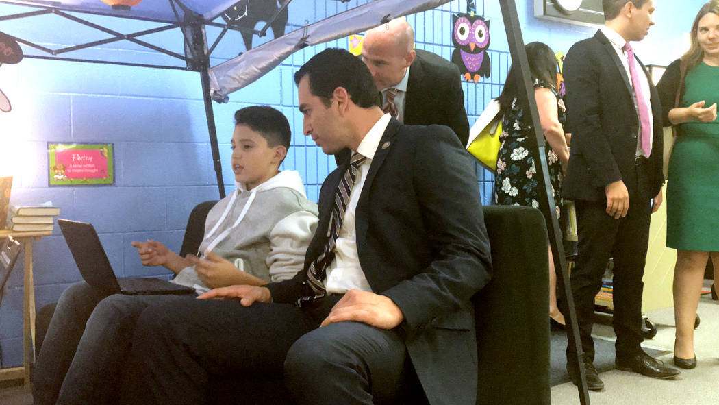 Rep. Ruben Kihuen checks a student's work Monday at O'Callaghan Middle School. Amelia Pak-Harvey Las Vegas Review-Journal