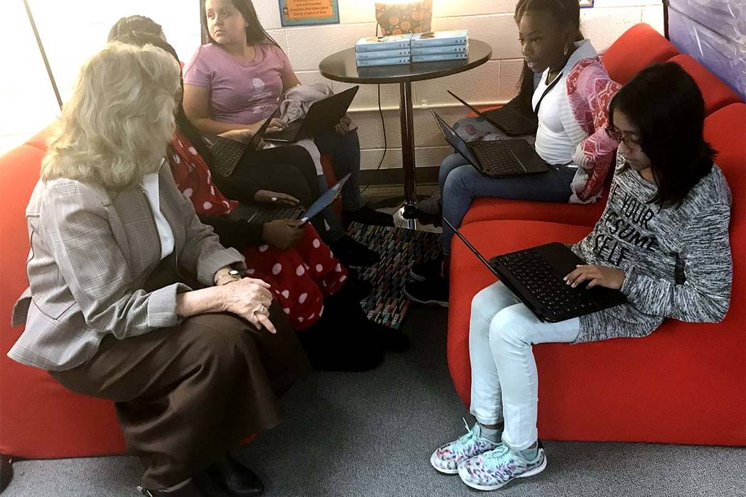 Rep. Dina Titus, left, talks to sixth-graders at O'Callaghan Middle School in Las Vegas on Monday. Amelia Pak-Harvey Las Vegas Review-Journal