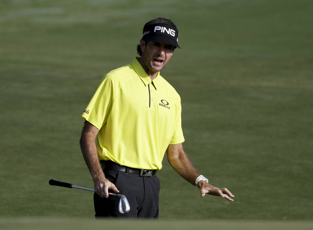 Bubba Watson reacts to his chip on the 10th hole during the first round of the PGA Championship golf tournament at the Quail Hollow Club Thursday, Aug. 10, 2017, in Charlotte, N.C. (AP Photo/Chris ...