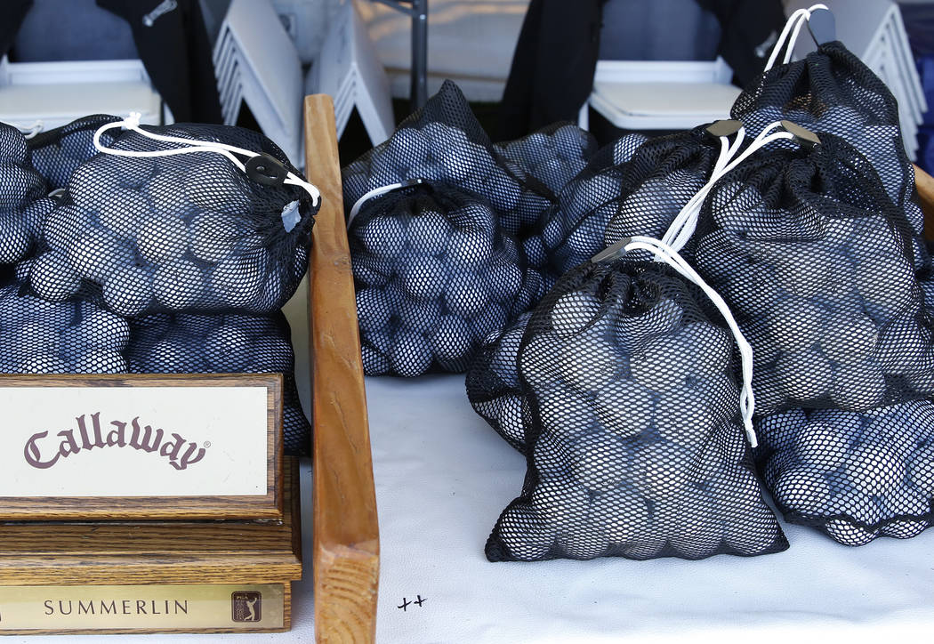 Bags of golf balls placed at a driving range as players prepare for the Shrine Hospitals for Children Open golf tournament at TPC Summerlin Tuesday, Oct. 31, 2017, in Las Vegas. Bizuayehu Tesfaye/ ...