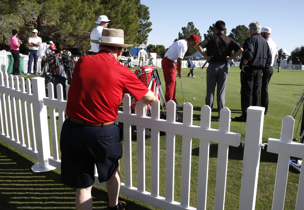 Kurt Wensler of Canada watches as players practice their putting as they prepare for the Shrine Hospitals for Children Open golf tournament at TPC Summerlin Tuesday, Oct. 31, 2017, in Las Vegas. B ...