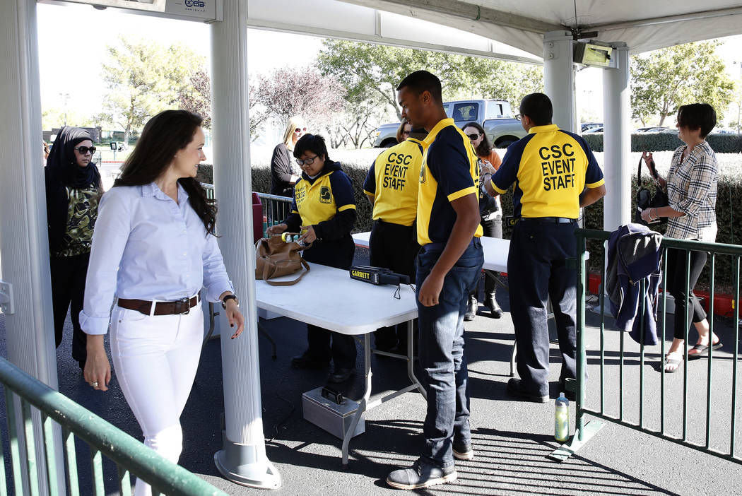 Fans walk-through metal detectors to watch as players practice for the Shrine Hospitals for Children Open golf tournament at TPC Summerlin Tuesday, Oct. 31, 2017, in Las Vegas. Bizuayehu Tesfaye/L ...