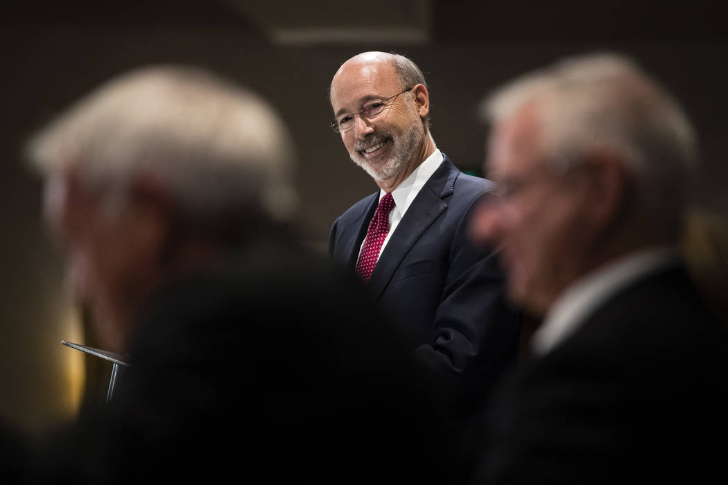 Pennsylvania Gov. Tom Wolf takes questions at a Pennsylvania Press Club luncheon in Harrisburg, Pa., Monday, Oct. 30, 2017. Wolf has approved legislation authorizing a major expansion of gambling  ...