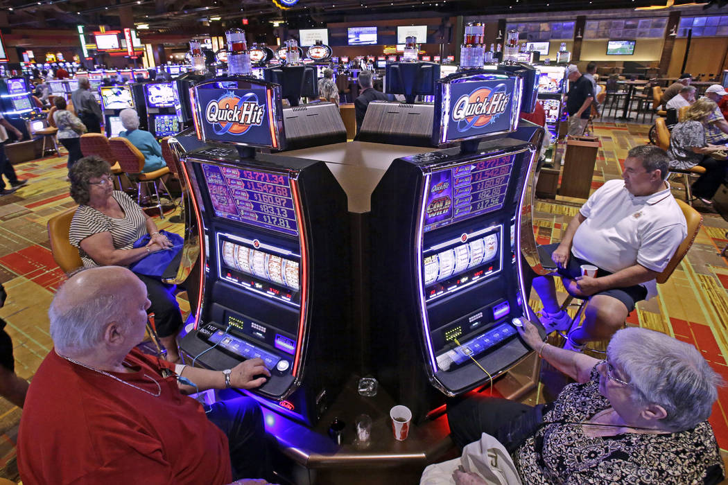 In this July 1, 2013 file photo, casino patrons play some of the 600 slot machines at the Lady Luck Casino Nemacolin, located approximately 70 miles south of Pittsburgh, shortly after its grand op ...