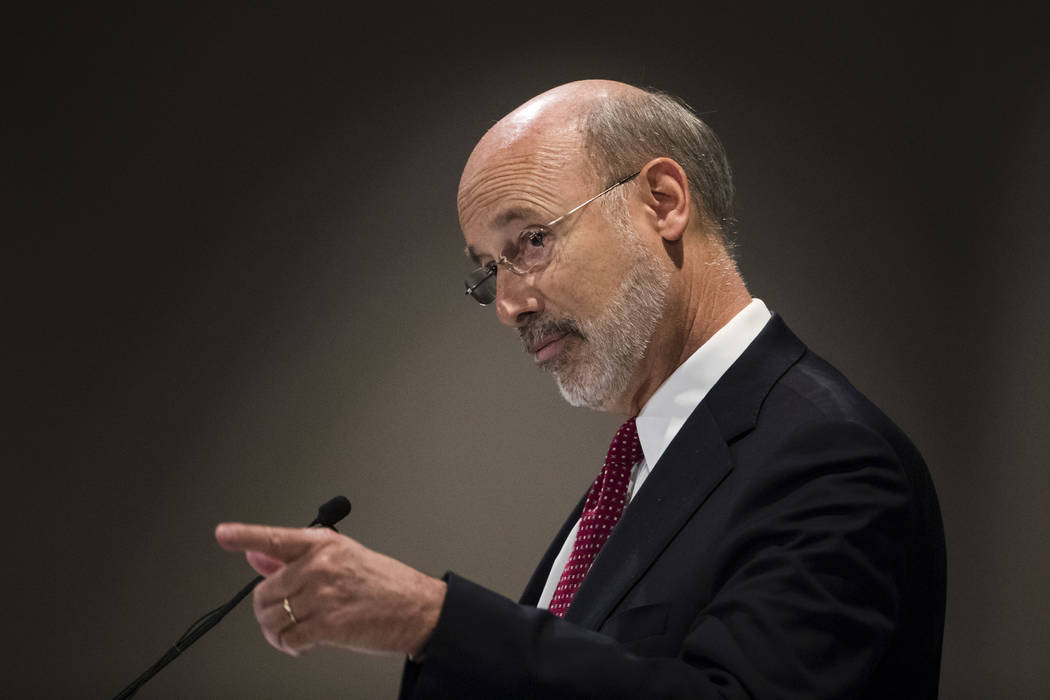 Pennsylvania Gov. Tom Wolf gestures as he speaks at a Pennsylvania Press Club luncheon in Harrisburg, Pa., Monday, Oct. 30, 2017. Wolf has approved legislation authorizing a major expansion of gam ...