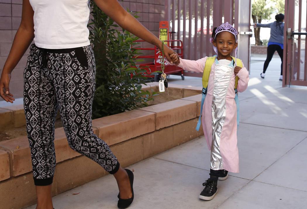 Sariah Thomas, 4, dressed like a princess arrives with her mother Candace at Mabel Hoggard Elementary School on Tuesday, Oct. 31, 2017. Bizuayehu Tesfaye/Las Vegas Review-Journal @bizutesfaye