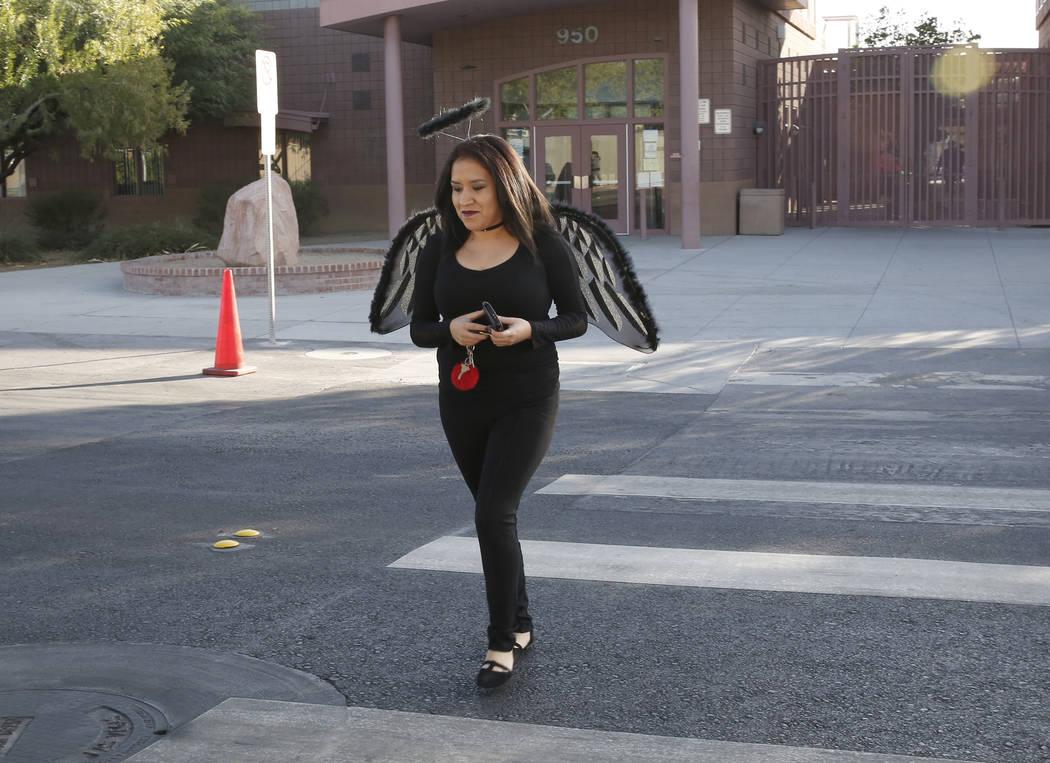Viviana Zamorano dressed as a fallen angel crosses Tonopa Drive near Mabel Hoggard Elementary School on Tuesday, Oct. 31, 2017. Bizuayehu Tesfaye/Las Vegas Review-Journal @bizutesfaye