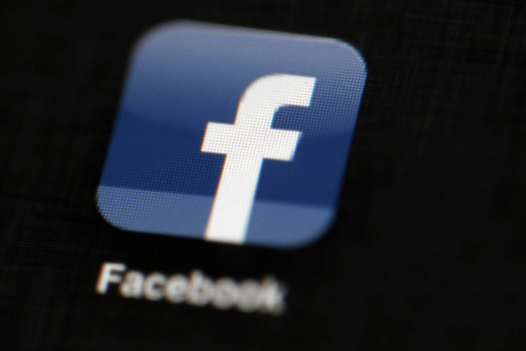 The Facebook logo is displayed on an iPad in Philadelphia on May 16, 2012. (Matt Rourke/AP)