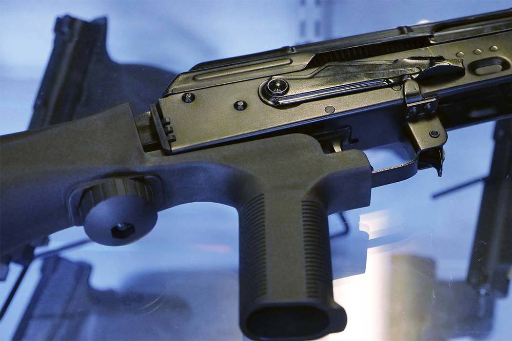 """In this Oct. 4, 2017, photo, a device called a """"bump stock"""" is attached to a semi-automatic rifle at the Gun Vault store and shooting range in South Jordan, Utah. The National Rifle Association an ..."""