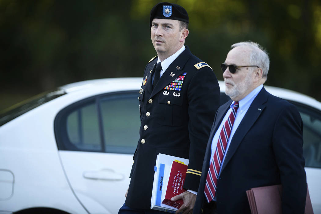 Sgt. Bowe Bergdahl's military attorney, Lt. Col. Franklin Rosenblatt, and his civilian attorney, Eugene Fidell, arrive at the Fort Bragg courthouse for a sentencing hearing on Wednesday, Oct. 25,  ...