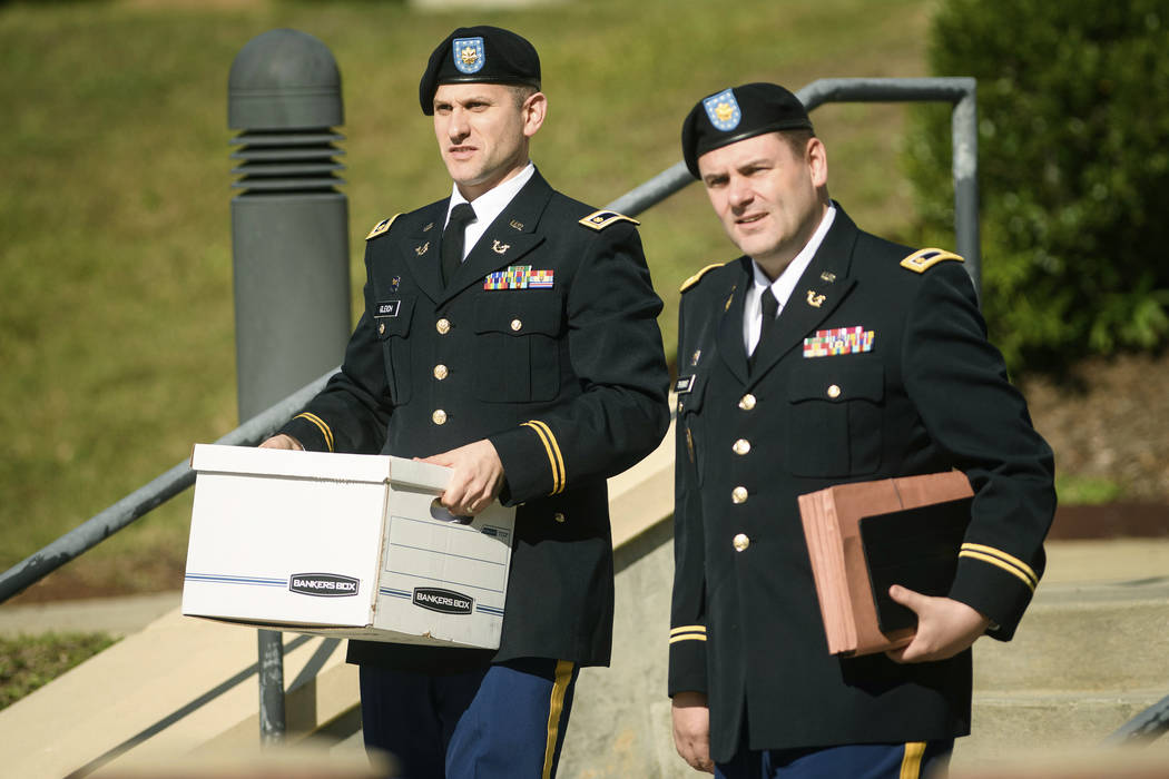 Two of Army Sgt. Bowe Bergdahl's defense attorneys, Maj. Oren Gleich, left, and Maj. Justin Thomas leave the Fort Bragg courthouse on Wednesday, Oct. 25, 2017, on Fort Bragg, N.C. Bergdahl, who wa ...