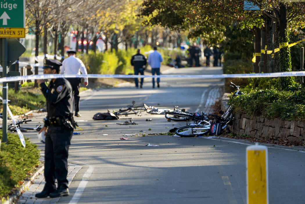 Bicycles and debris lay on a bike path after a motorist drove onto the path near the World Trade Center memorial, striking and killing several people Tuesday, Oct. 31, 2017, in New York. (AP Photo ...