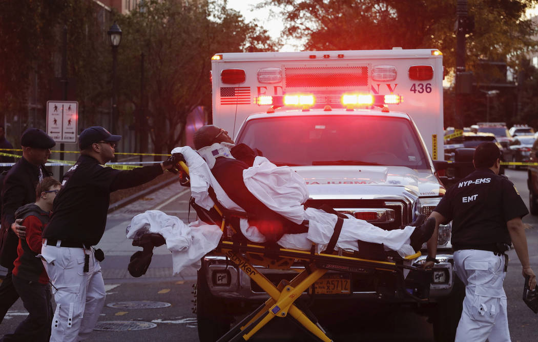 Emergency personnel transport a man on a stretcher after a motorist drove onto a busy bicycle path near the World Trade Center memorial and struck several people Tuesday, Oct. 31, 2017, in New Yor ...