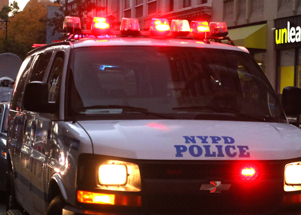 A New York Police Department van on Chambers Street in lower Manhattan after a man in a rented pickup truck mowed down pedestrians and cyclists along a busy bike path near the World Trade Center m ...