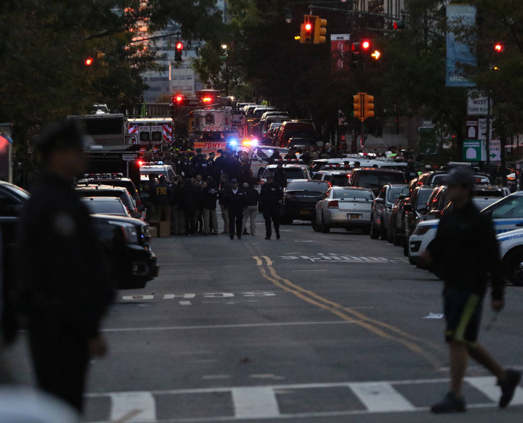 The New York Police and Fire Department assemble on Chambers Street in lower Manhattan after a man in a rented pickup truck mowed down pedestrians and cyclists along a busy bike path near the Worl ...