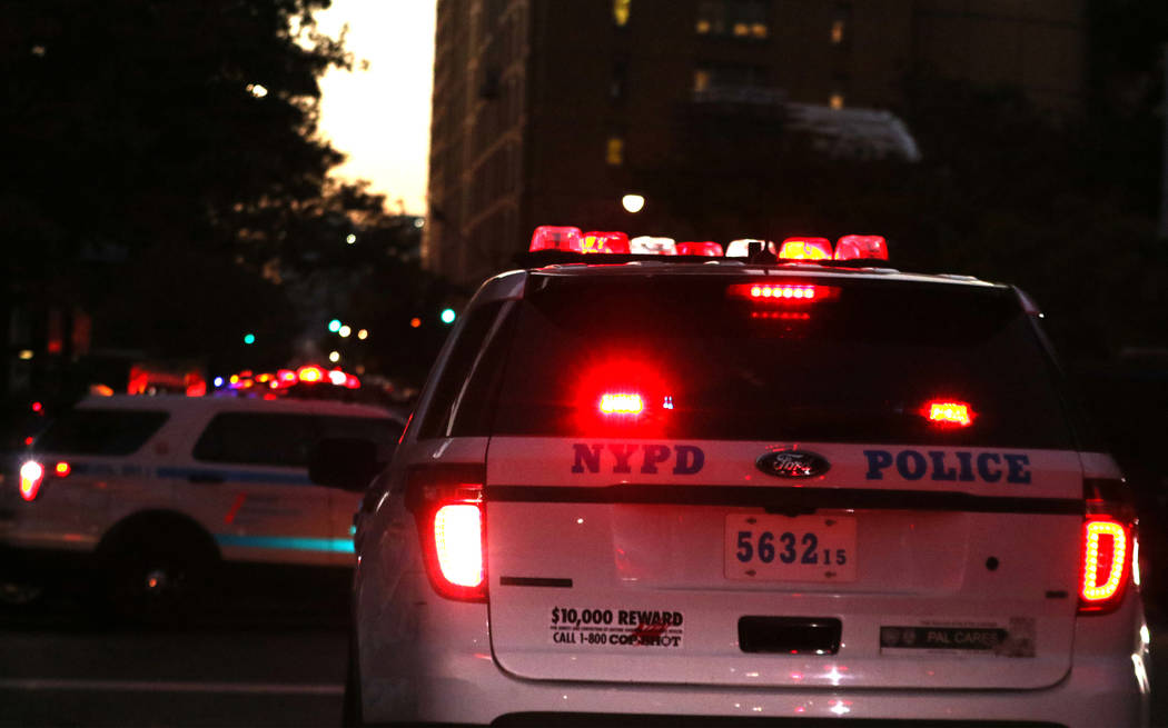 A New York Police Department vehicle on Chambers Street in lower Manhattan after a man in a rented pickup truck mowed down pedestrians and cyclists along a busy bike path near the World Trade Cent ...