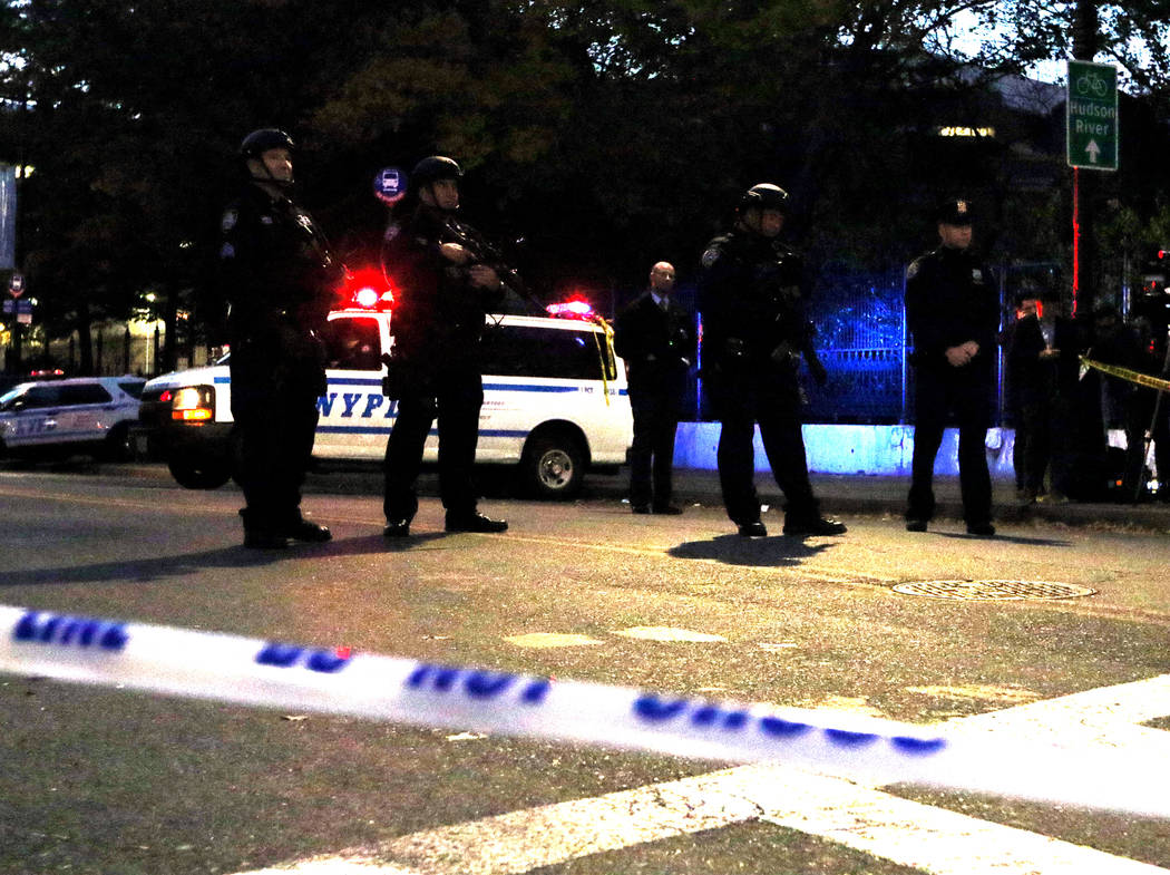 New York police block Chambers Street in lower Manhattan after a man in a rented pickup truck mowed down pedestrians and cyclists along a busy bike path near the World Trade Center memorial on Tue ...