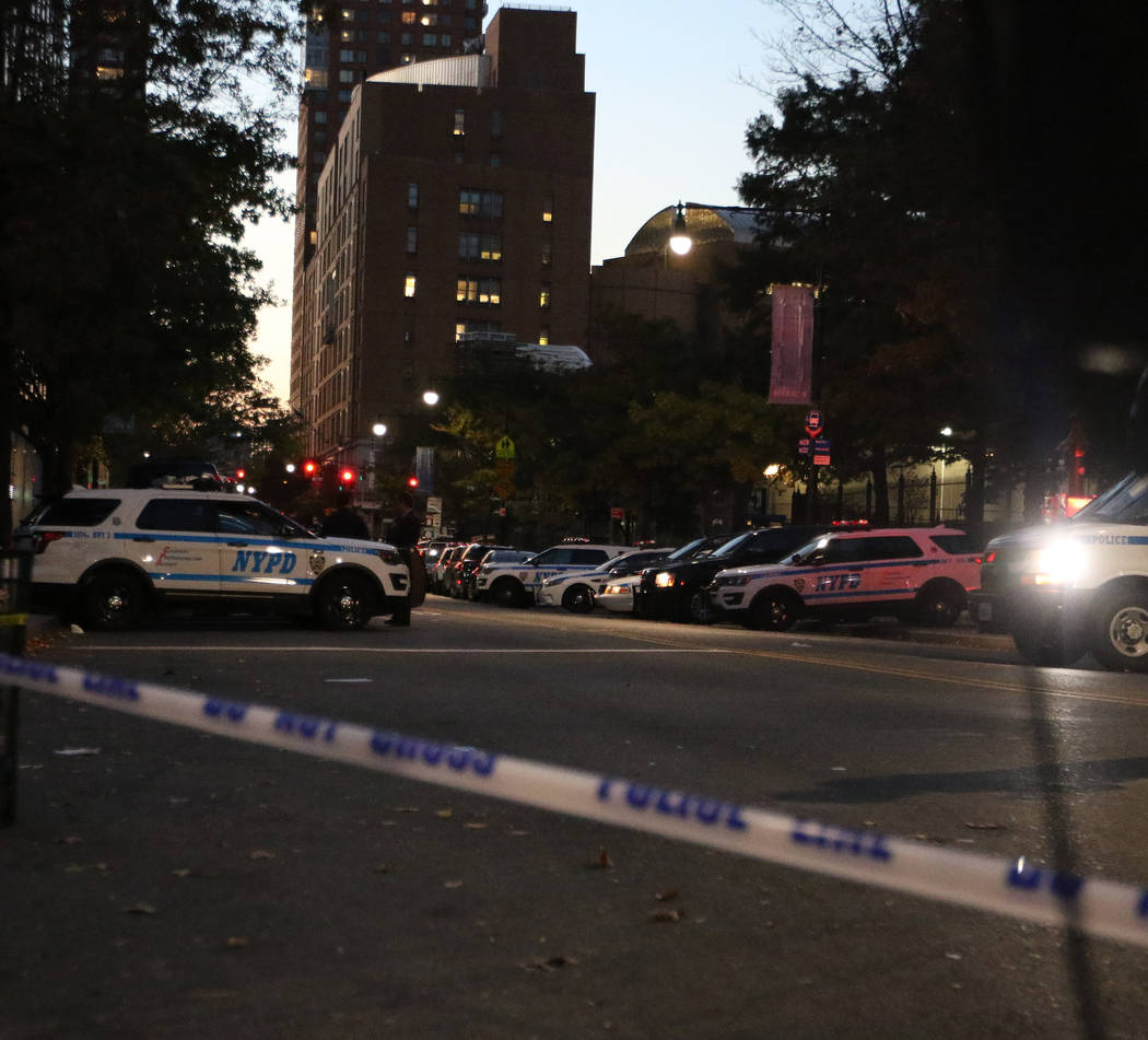 New York Police Department vehicles line Chambers Street in lower Manhattan after a man in a rented pickup truck mowed down pedestrians and cyclists along a busy bike path near the World Trade Cen ...