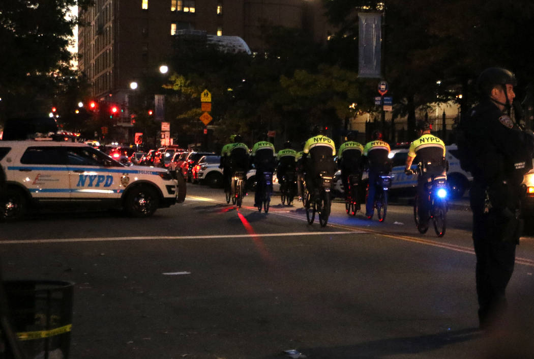 New York police on bicycles patrol Chambers Street in lower Manhattan after a man in a rented pickup truck mowed down pedestrians and cyclists along a busy bike path near the World Trade Center me ...