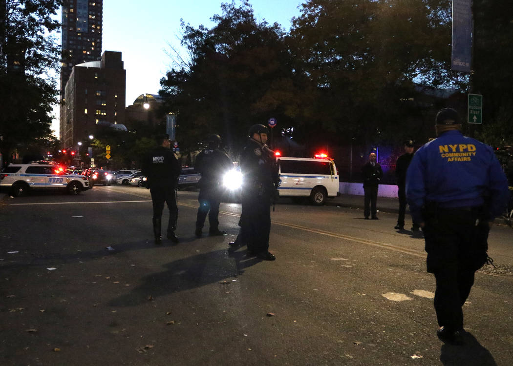New York police patrol Chambers Street in lower Manhattan after a man in a rented pickup truck mowed down pedestrians and cyclists along a busy bike path near the World Trade Center memorial on Tu ...
