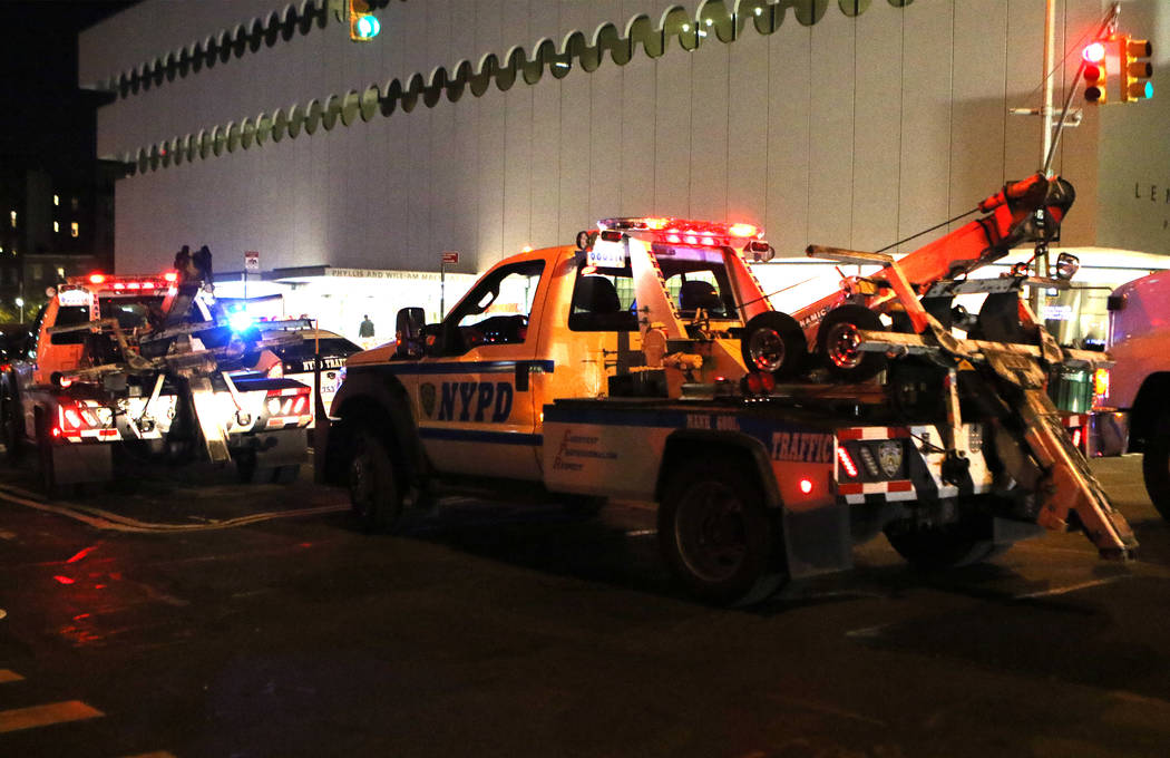 New York Police Department vehicles barricade West 13th Street and 7th Avenue in Manhattan's Greenwich Village during the Halloween parade after a man in a rented pickup truck mowed down pedestria ...