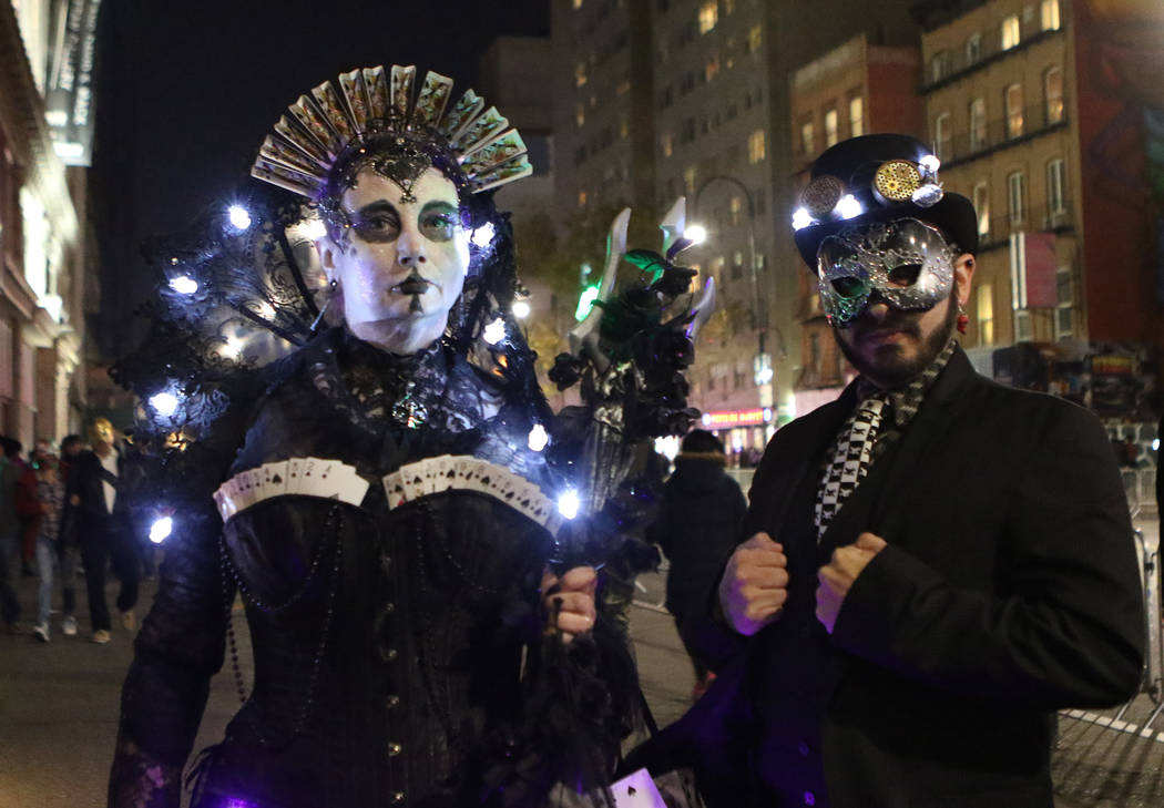 Tina Phillips of Australia, left, and Casper Snyder from New York attend the Halloween parade in Greenwich Village Manhattan on the same day a man in a rented pickup truck mowed down pedestrians a ...