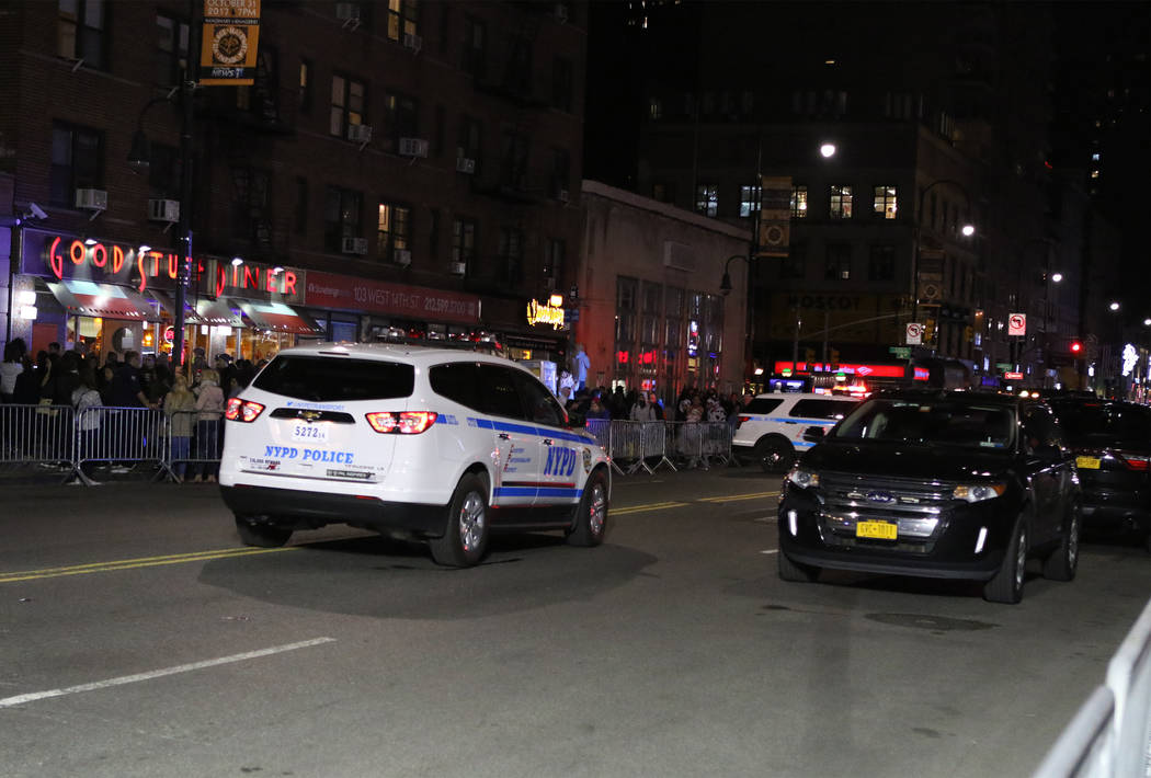 New York Police Department vehicles barricade West 14th Street near 6th Avenue in Manhattan's Greenwich Village during the Halloween parade after a man in a rented pickup truck mowed down pedestri ...
